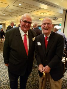 Attorneys Robert Skemp and Tom Sleik stand side-by-side smiling.