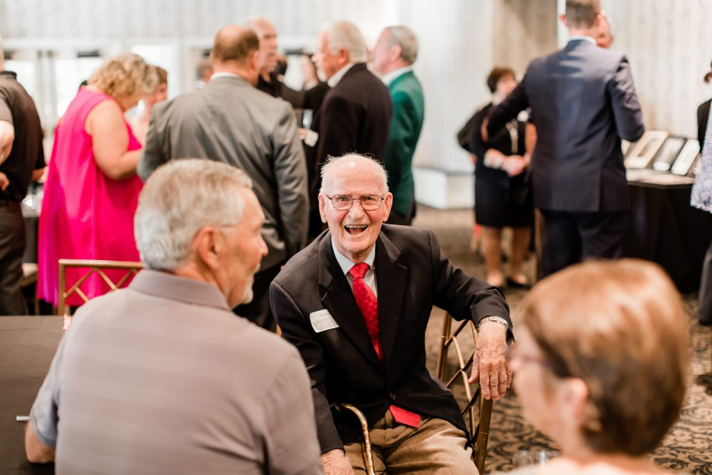 Robert C. Skemp smiles as he talks to guests at the 100th anniversary celebration.