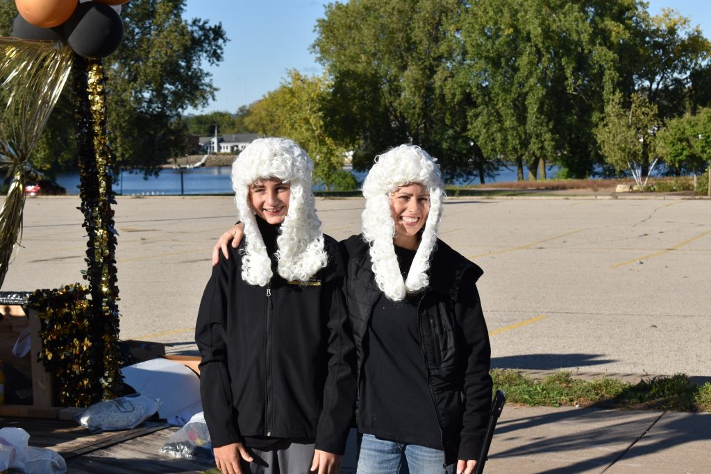 two people wearing white barrister wigs