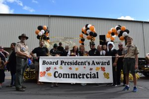 The Hale Skemp team poses with their float after winning the Board President's Award in the Maple Leaf Parade 2019.